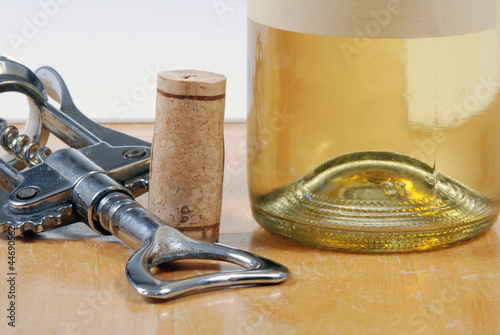 wine bottle with cork and corkscrew