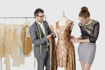 Fashion designers working together on an outfit in design studio