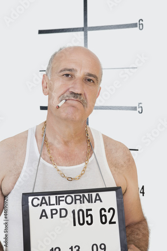 Mug shot of senior gangster smoking cigarette