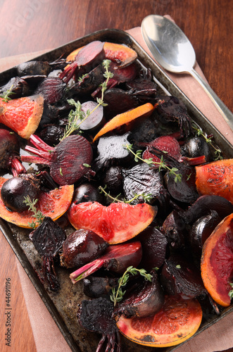Roasting tray of baby beets and citrus slices