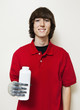 Portrait of a happy young man holding bottle with prosthetic hand over gray background