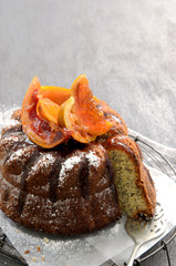 Delicious poppyseed cake with candied grapefruit topping