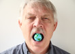 man with earth model in his mouth