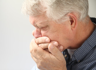 older man getting ready to vomit