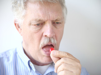 senior man with cough drop