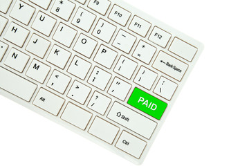 Wording Paid on computer keyboard isolated on white background