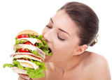 young woman biting a big sandwich