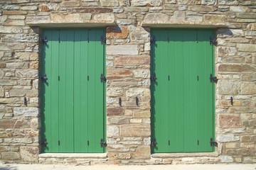 double green doors, stone wall