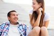 Teenage couple sitting
