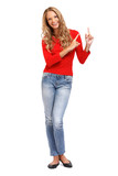 smiling blond woman pointing her finger towards copyspace