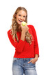 isolated portrait of a young blond woman eating apple