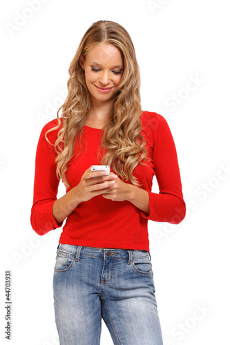 cute young blond woman reading an SMS on mobile
