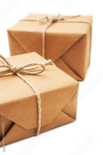 Parcel wrapped with brown paper tied with rope