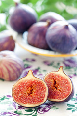 Ripe fresh Fig fruits on a beautiful tablecloth.