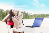 Businesswoman relaxing at beach