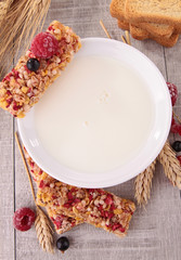 bowl of milk with granola and berries fruit