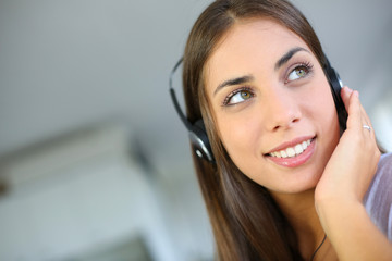 Portrait of beautiful girl with headphones on