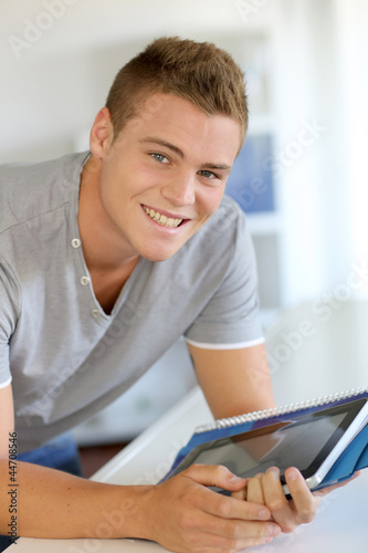 Portrait of student using electronic tablet