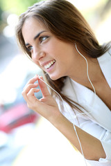 Beautiful girl talking with smartphone handsfree device