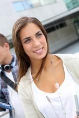 Portrait of student girl walking on university campus