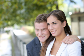 Cheerful young couple in town