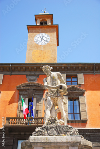 Italy, Reggio Emilia Crostolo statue and clock tower