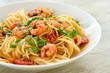 Leinwanddruck Bild - Spaghetti con gamberetti, pomodoro e prezzemolo