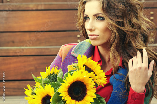 Fashion woman with sunflower at outdoor.