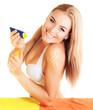 Pretty female apply suntan cream