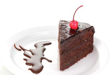 Chocolate sacher cake close-up isolated on white