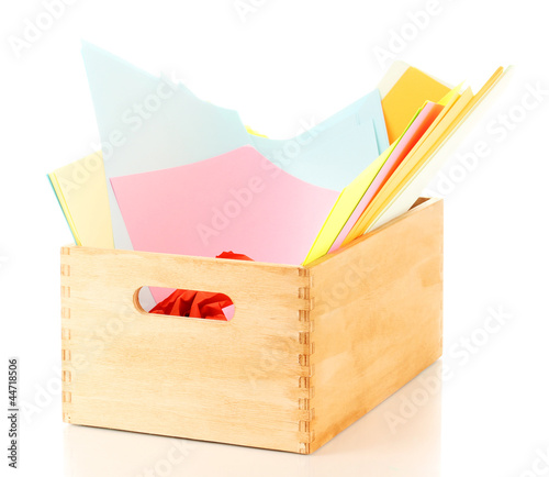 Wooden crate with colorful papers isolated on white