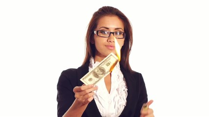Smart businesswoman burns dollars, bankrupt concept