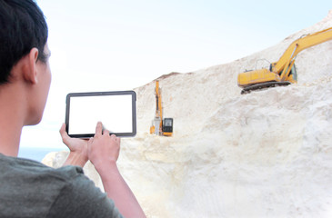Architect with tablet pc planning on building something