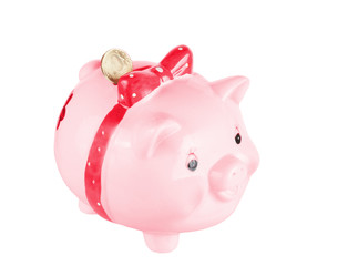 Pink a pig-coin box with a coin