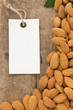 nuts almond and tag price label on wood