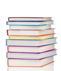 stack of colorful books isolated on white