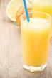 fresh fruits orange juice in glass on wood board