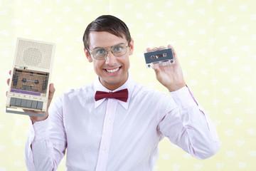 Man Holding Old Audio Cassette