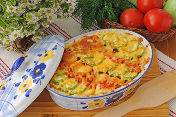casserole of pasta with zucchini and tomato with cheese