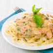 Pasta with mushrooms, smoked sausage and cream sauce with basil