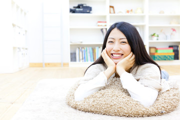 a young asian woman relaxing in the room