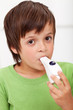 Boy with inhaler - closeup