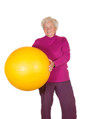 Happy retired woman holding gym ball