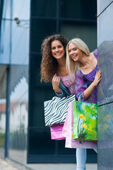 two woman friends shopping