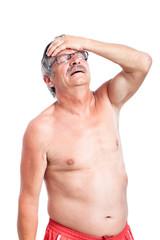 Unhappy senior man with headache