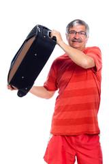 Senior man holding luggage