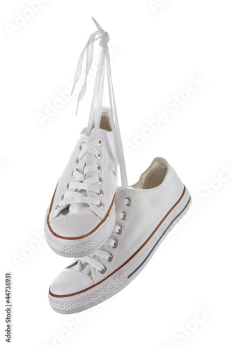Pair of new white sneakers isolated on white