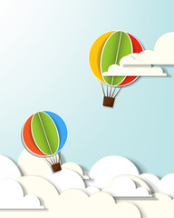 two hot air balloons in the clouds