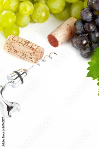 Grapes and corks over white