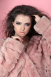 Winter Girl in Luxury Fur Coat over pink